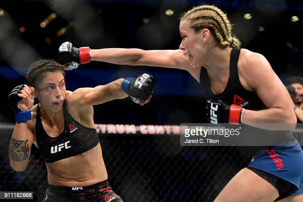 Katlyn Chookagian and Mara Romero Borella of Italy throw punches in their flyweight bout during the UFC Fight Night event inside the Spectrum Center...