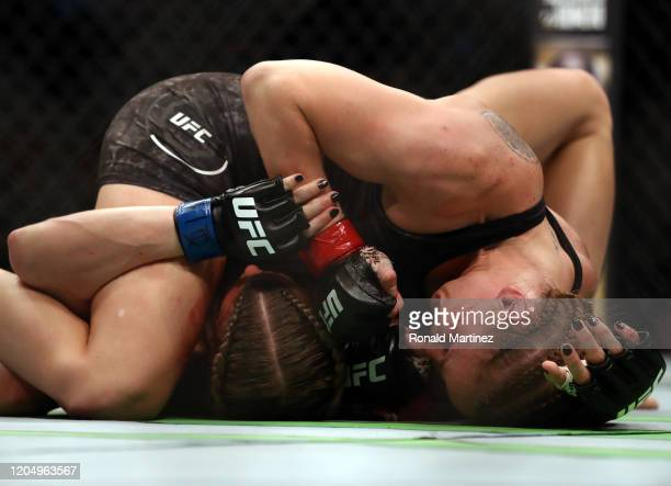 Katlyn Chookagian and Valentina Shevchenko in their Women's Flyweight Championship bout during UFC 247 at Toyota Center on February 08 2020 in...