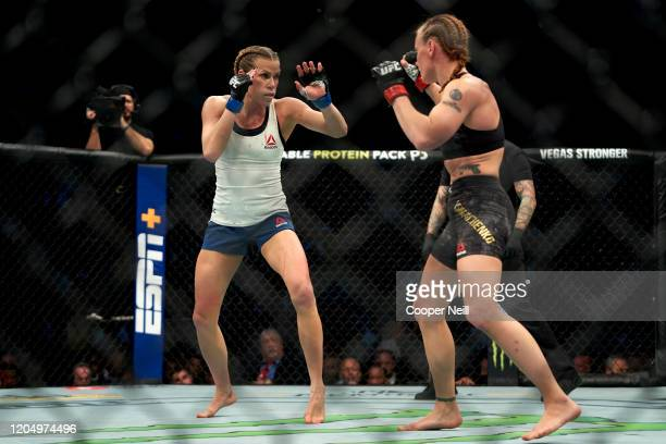 Katlyn Chookagian and Valentina Shevchenko of Kyrgyzstan battle in their women's flyweight championship bout during the UFC 247 event at Toyota...