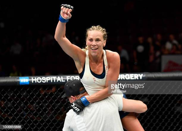 Katlyn Chookagian celebrates after the conclusion of her women's flyweight bout against Alexis Davis of Canada during the UFC Fight Night event at...
