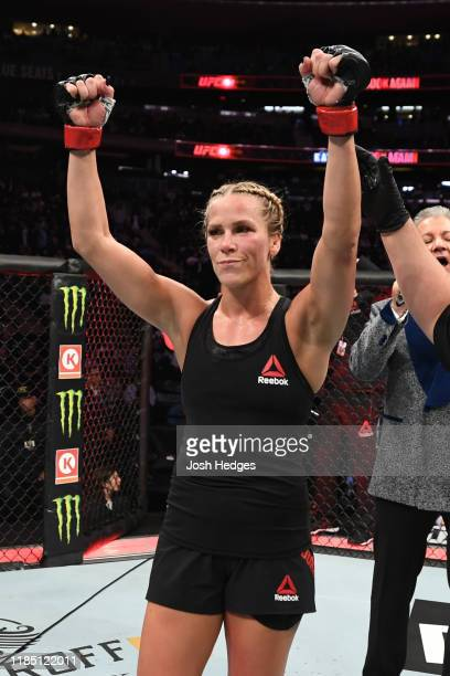 Katlyn Chookagian celebrates her victory over Jennifer Maia of Brazil in their women's flyweight bout during the UFC 244 event at Madison Square...