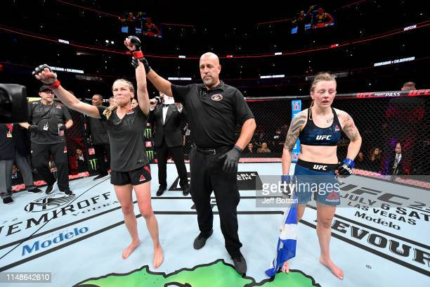 Katlyn Chookagian celebrates her victory over Joanne Calderwood of Scotland in their women's flyweight bout during the UFC 238 event at the United...