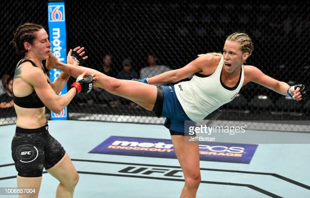 Katlyn Chookagian kicks Alexis Davis of Canada in their women's flyweight bout during the UFC Fight Night event at Scotiabank Saddledome on July 28...