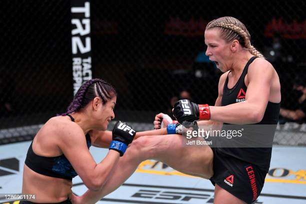 Katlyn Chookagian kicks Cynthia Calvillo in their women's flyweight bout during the UFC 255 event at UFC APEX on November 21, 2020 in Las Vegas,...