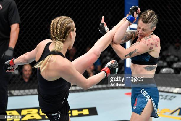 Katlyn Chookagian kicks Joanne Calderwood of Scotland in their women's flyweight bout during the UFC 238 event at the United Center on June 8 2019 in...
