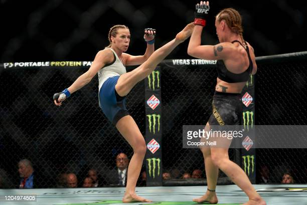 Katlyn Chookagian kicks Valentina Shevchenko of Kyrgyzstan in their women's flyweight championship bout during the UFC 247 event at Toyota Center on...