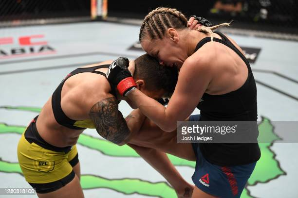 Katlyn Chookagian knees Jessica Andrade of Brazil in their women's flyweight bout during the UFC Fight Night event inside Flash Forum on UFC Fight...