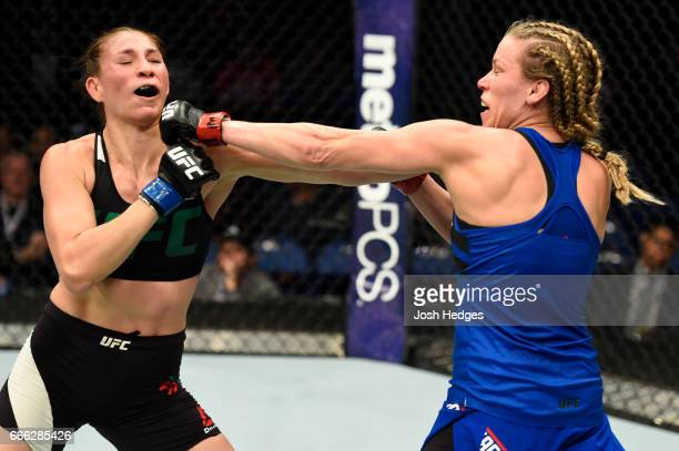 Katlyn Chookagian lands a punch on Irene Aldana of Mexico in their women's bantamweight bout during the UFC 210 event at KeyBank Center on April 8...