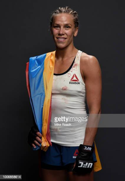 Katlyn Chookagian poses for a portrait backstage after her victory over Alexis Davis during the UFC Fight Night event at Scotiabank Saddledome on...