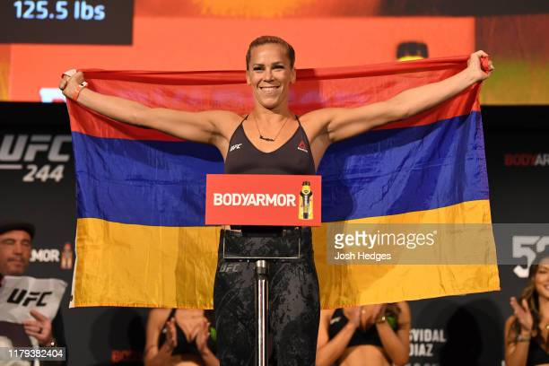 Katlyn Chookagian poses on the scale during the UFC 244 weighins at the Hulu Theatre at Madison Square Garden on November 1 2019 in New York New York