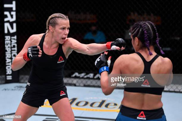 Katlyn Chookagian punches Cynthia Calvillo in their women's flyweight bout during the UFC 255 event at UFC APEX on November 21, 2020 in Las Vegas,...