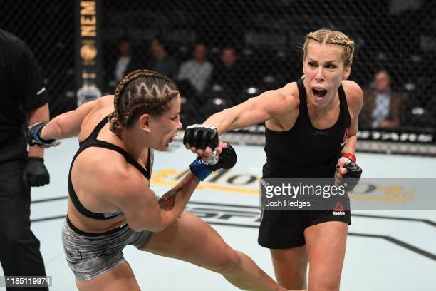 Katlyn Chookagian punches Jennifer Maia of Brazil in their women's flyweight bout during the UFC 244 event at Madison Square Garden on November 02...