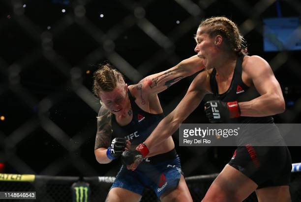 Katlyn Chookagian punches Joanne Calderwood at United Center on June 8 2019 in Chicago Illinois
