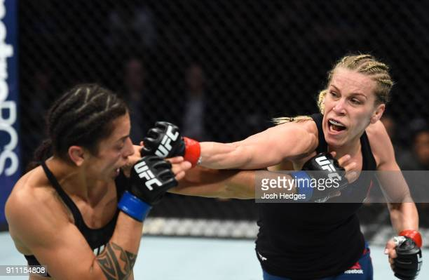 Katlyn Chookagian punches Mara Romero Borella of Italy in their women's flyweight bout during a UFC Fight Night event at Spectrum Center on January...