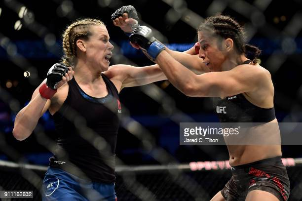 Katlyn Chookagian punches Mara Romero Borella of Italy in their flyweight bout during the UFC Fight Night event inside the Spectrum Center on January...