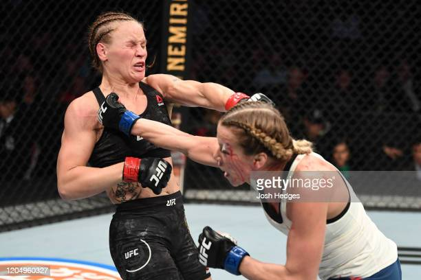 Katlyn Chookagian punches Valentina Shevchenko of Kyrgyzstan in their women's flyweight championship bout during the UFC 247 event at Toyota Center...