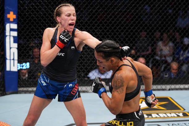 Katlyn Chookagian punches Viviane Araujo of Brazil in their women's flyweight bout during the UFC 262 event at Toyota Center on May 15, 2021 in...