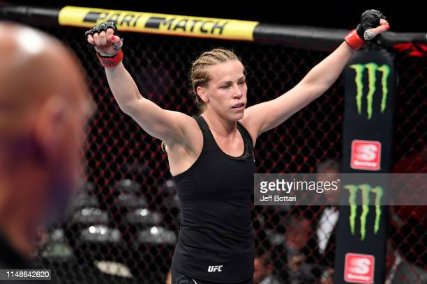 Katlyn Chookagian reacts after her women's flyweight bout against Joanne Calderwood of Scotland during the UFC 238 event at the United Center on June...