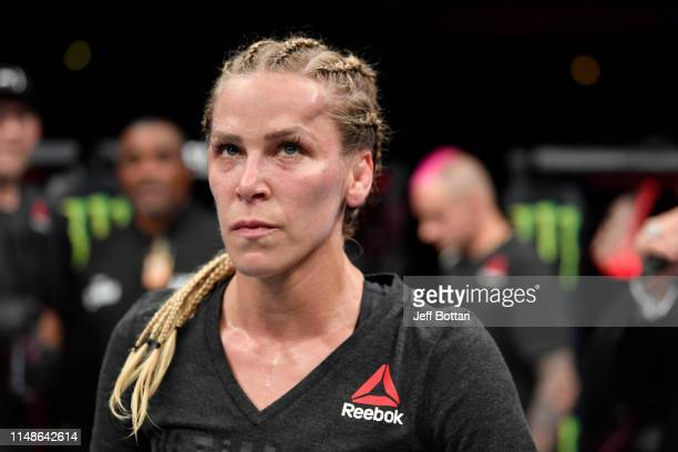 Katlyn Chookagian waits for the judge's decision after her women's flyweight bout against Joanne Calderwood of Scotland during the UFC 238 event at...