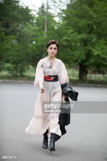 Kato Gogashvili wears her grandmother's vintage tan nightgown with a belt and black boots on May 5, 2018 in Tbilisi, Georgia.