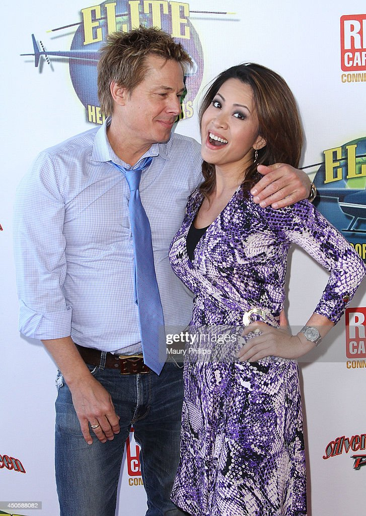 Kato Kaelin and Leyna Nguyen arrive at Lorenzo Lamas' New Business Elite Helicopter launch party at the Van Nuys Airport on June 13, 2014 in Van Nuys, California.