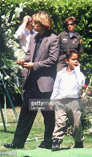 Kato Kaelin OJ Simpson's house guest and Justin Simpson Simpson's son attend the internment of Simpson's exwife nicole Brown Simpson June 16 1994