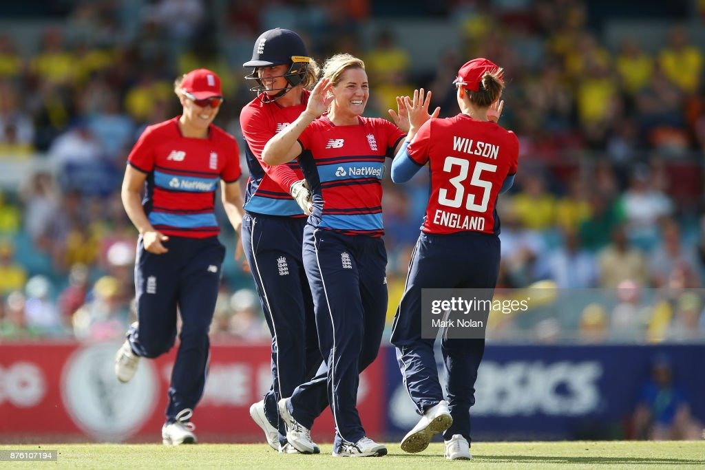 Katrherine Brunt of England celebrates a wicket with team mates during the second Women's Twenty20 match between Australia and England at Manuka Oval on November 19, 2017 in Canberra, Australia.