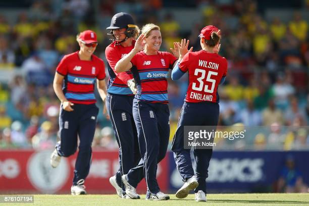 Katrherine Brunt of England celebrates a wicket with team mates during the second Women's Twenty20 match between Australia and England at Manuka Oval...
