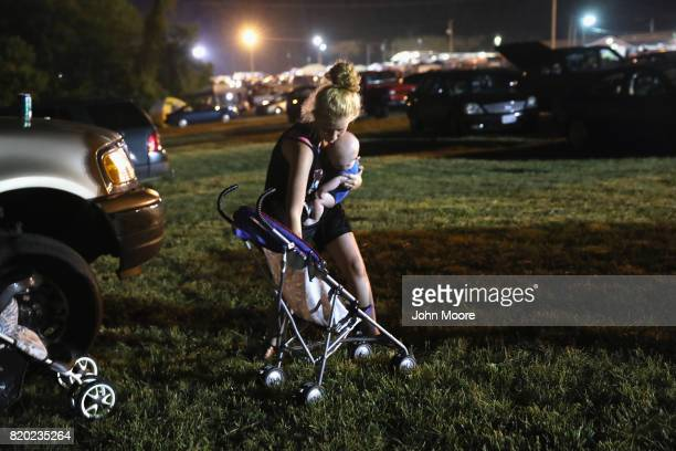 Katrice Miles 20 and her son Tyler 6 months prepare to enter the Remote Area Medical mobile clinic after sleeping in their car on July 21 2017 in...