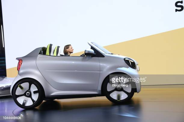 Katrin Adt chief executive officer of Daimler AG's Smart brand drives a Smart Forease electric compact automobile on stage at the Paris Motor Show in...