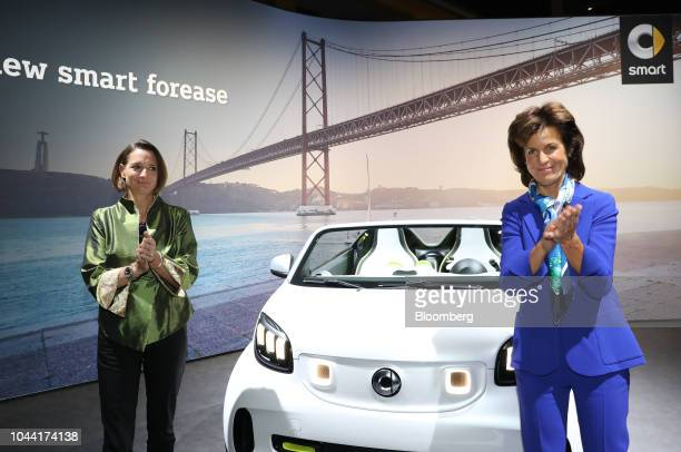 Katrin Adt chief executive officer of Daimler AG's Smart brand left and Annette Winkler board member at Daimler AG applaud as the new Smart Forease...