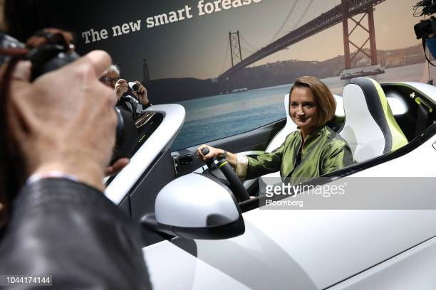 Katrin Adt chief executive officer of Daimler AG's Smart brand poses for a photograph inside a new Smart Forease compact electric automobile during...
