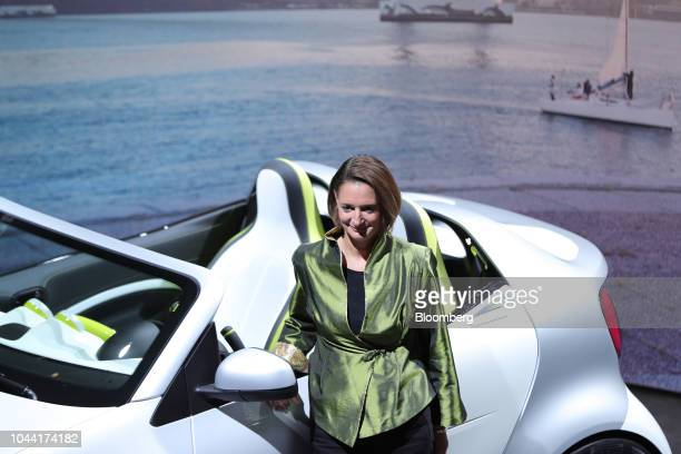 Katrin Adt chief executive officer of Daimler AG's Smart brand poses for a photograph beside a Smart Forease electric compact automobile at the...