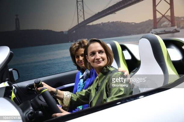 Katrin Adt chief executive officer of Daimler AG's Smart brand right and Annette Winkler board member at Daimler AG pose for a photograph inside a...