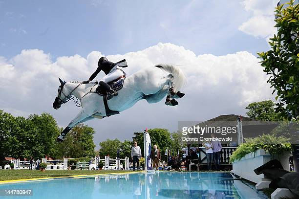 Katrin Eckermann of Germany and Carlson compete in the CSI5 Global Champions Tour Grand Prix of Hamburg during day three of the German Jumping...