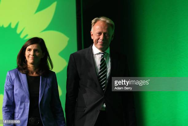 Katrin GoeringEckardt and Juergen Trittin colead candidates of the German Green Party leave the stage after speaking after the announcement of...