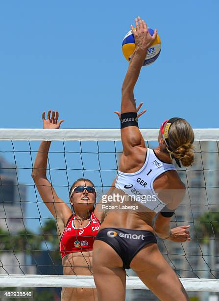 Katrin Holtwick of Germany spikes the ball against Taylor Pischke of Canada during the FIVB Long Beach Grand Slam on July 25, 2014 in Long Beach,...