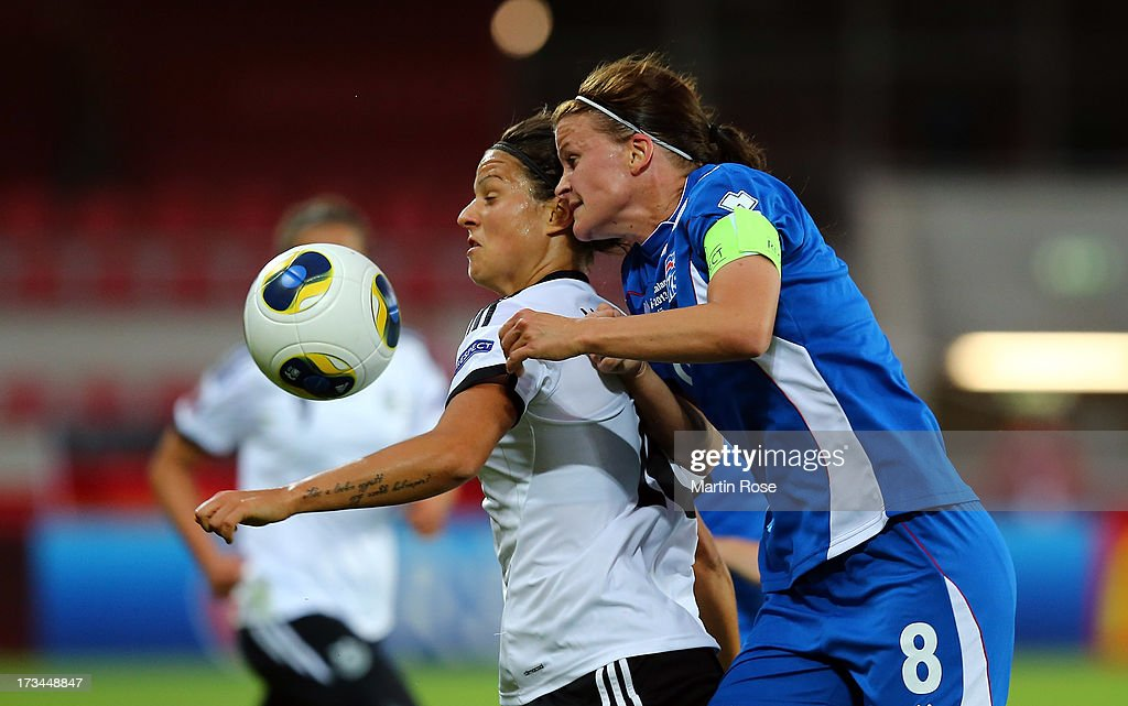 Katrin Jonsdottir (R) of Iceland and Dzsenifer Marozsan (L) of Germany battle for the ball during the UEFA Women's Euro 2013 group B match between Iceland and Germany at Vaxjo Arena on July 14, 2013 in Vaxjo, Sweden.