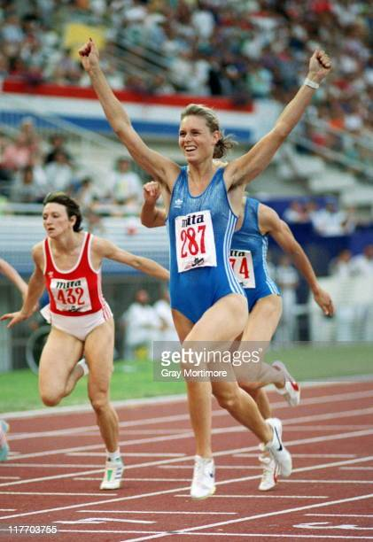 Katrin Krabbe of East Germany celebrates winning the Women's 200 metres at the 15th European Athletics Championships on 30th August 1990 at the...