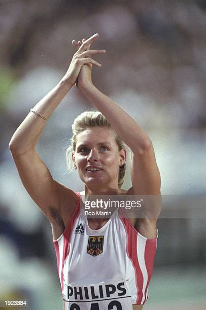 Katrin Krabbe of Germany celebrates after winning the 100 metres final during the World Championships at the Olympic Stadium in Tokyo Krabbe won the...