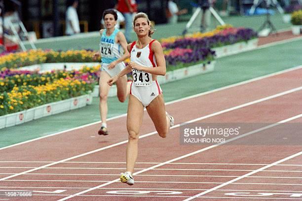 Katrin Krabbe of Germany clocks 2246 sec to finish first in the second roundof the women's 200 meters at the 3rd World Athletics Championships on...
