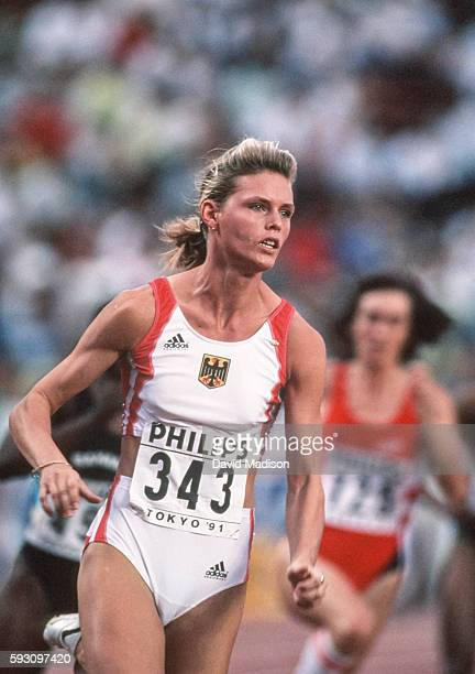 Katrin Krabbe of Germany competes in the 200 meter event of the 1991 IAAF World Championships during August 1991 at the National Olympic Stadium in...