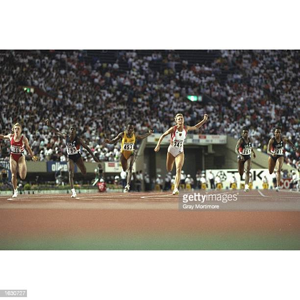 Katrin Krabbe of Germany Merlene Ottey of Jamaica and Gwen Torrence of the USA cross the line during the 100 metres event at the World Championships...