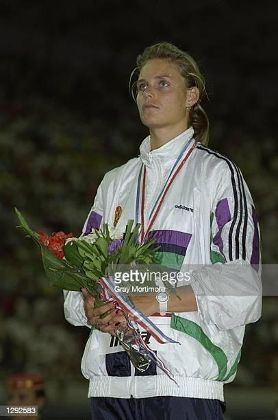 Katrin Krabbe of the German Democratic Republic stands on the podium after winning the gold medal in the 200 metres event during the European...