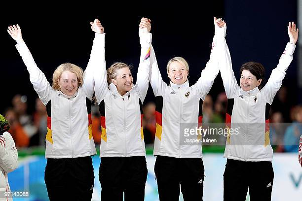 Katrin Mattscherodt Anni FriesingerPostma Stephanie Beckert and Daniela Anschutz Thoms of Germany celebrate winning the gold medal during the flower...