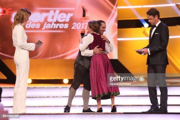 Katrin MuellerHohenstein Alexander Huber Biathlete Laura Dahlmeier with award and Rudi Cerne during the 'Sportler des Jahres 2017' Gala at Kurhaus...