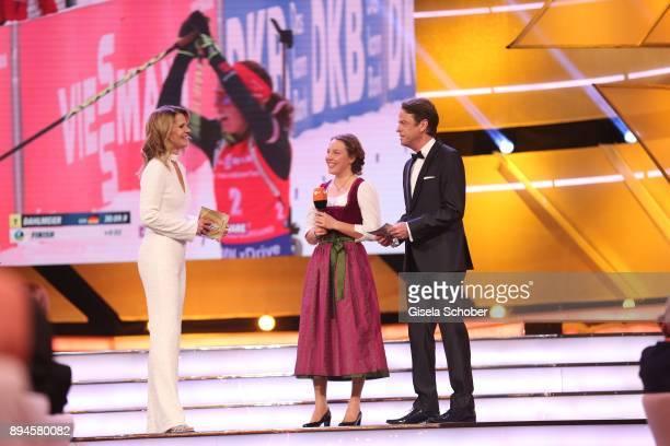 Katrin MuellerHohenstein Biathlete Laura Dahlmeier with award and Rudi Cerne during the 'Sportler des Jahres 2017' Gala at Kurhaus BadenBaden on...