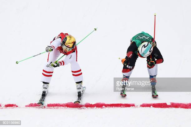 Katrin Ofner of Austria and Sanna Luedi of Switzerland compete during the Freestyle Skiing Ladies' Ski Cross 1/8 Finals on day fourteen of the...