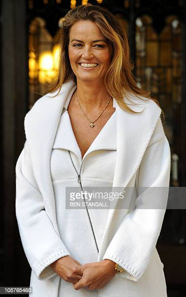 Katrin Radmacher poses for photographers as she leaves the Supreme Court in central London on October 20 2010 Britain's highest court ruled in favour...