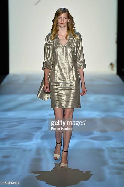 Katrin Thormann walks the runway at Minx By Eva Lutz show during Mercedes-Benz Fashion Week Spring/Summer 2014 at Brandenburg Gate on July 3, 2013 in...